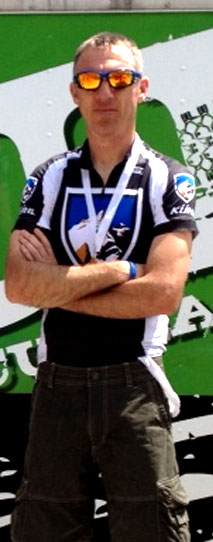 Christian standing on the podium of an Intermountain Cup race