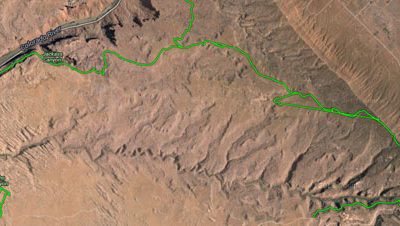 The green is the PRT, notice how it skirts the edge of that cliff in the beginning, then drops to the Colorado River
