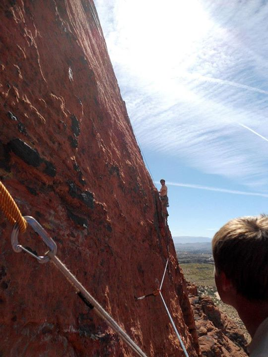Ben leading the traverse pitch on Leopard Skin in St. George