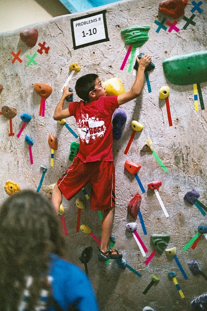 Caption: Climbers of all ages compete in a fair, fun, and intense local ABS