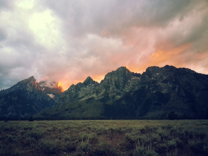 The Tetons with the fire of sunset behind them