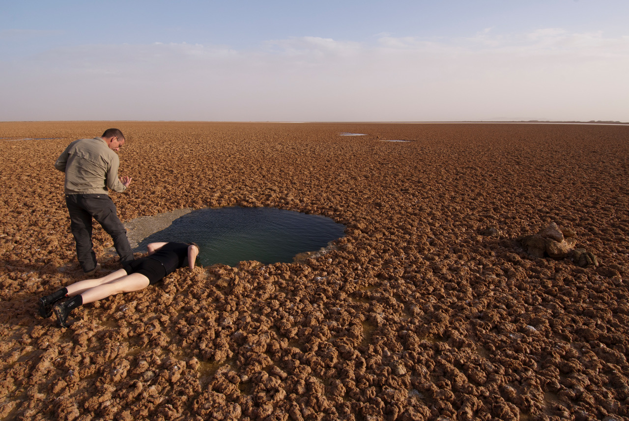 Investigating strange mudflats in the Western Desert of Egypt near the Libyan border on a National Geographic expedition. Photo: Jaqueline Windh