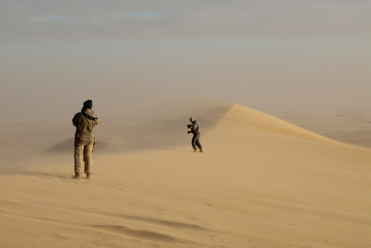 A sandstrom approaches while Heinerth tries to get a her shots on a National Geographic expedition in Egypt. Photo: Jacqueline Windh