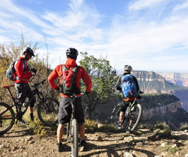 Biking along the Rainbow Rim Trail in Grand Canyon National Park.