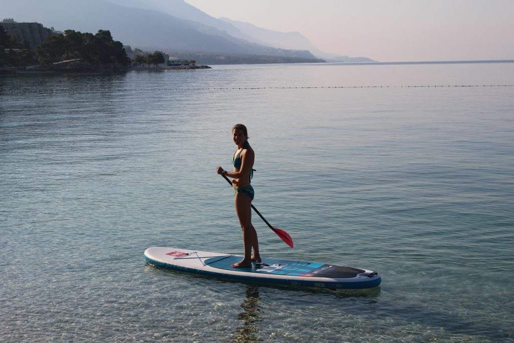 A woman paddling in Brela, Croatia.