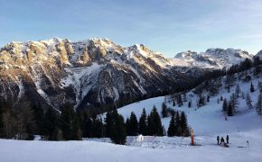 A breathtaking snowy mountain range of a ski track in Italy