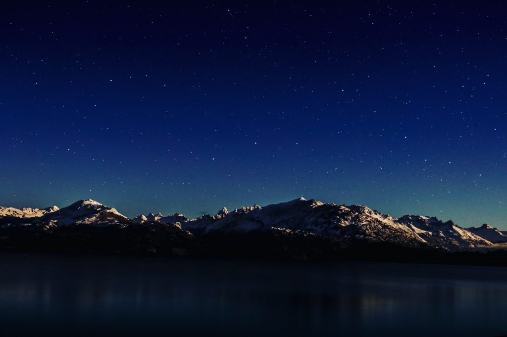 Night sky over Chile's New Patagonia Park Trail, mountains in the distance.