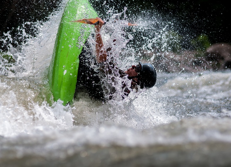Whitewater Rafting 101 - A man falling in water.