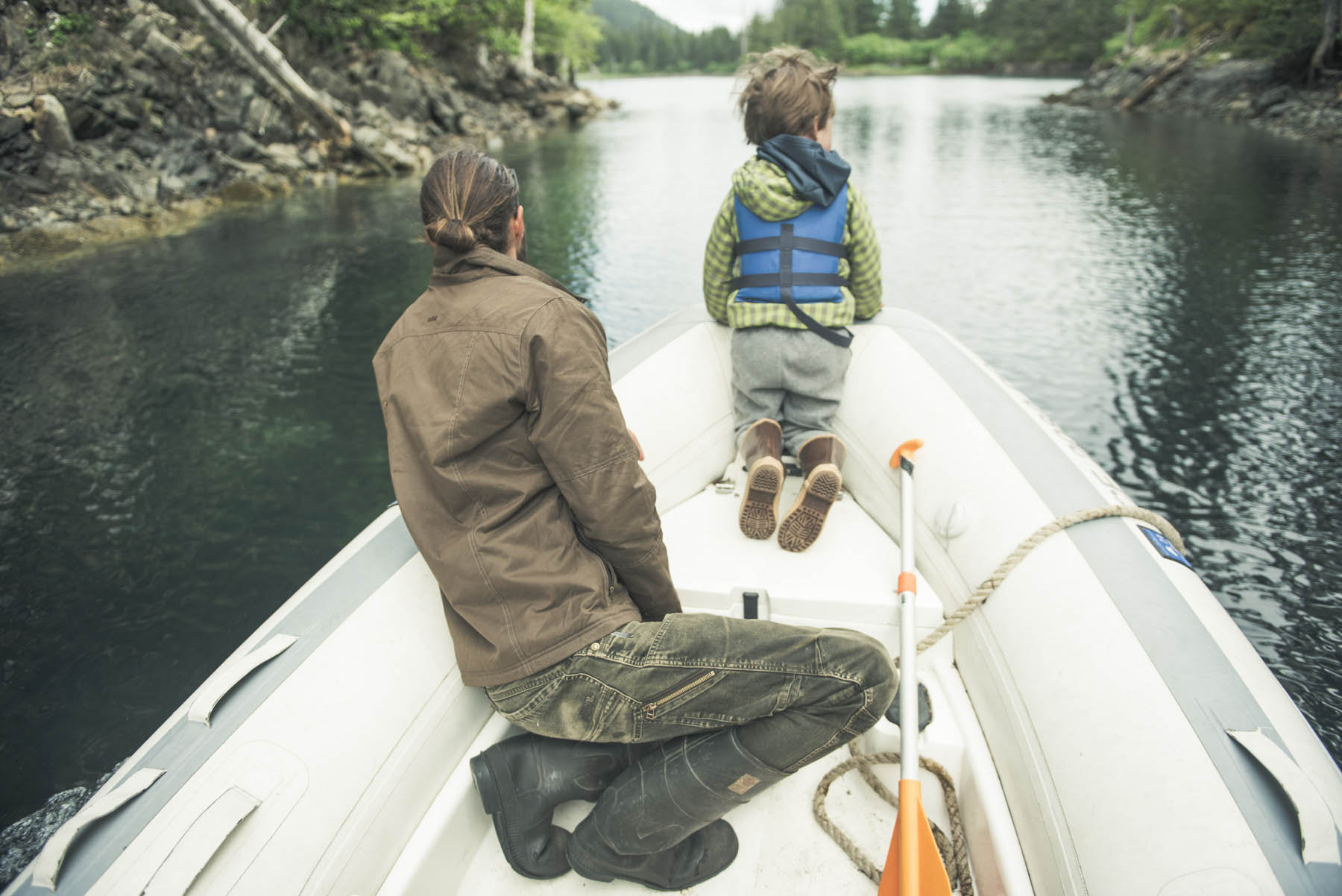 Lessons from Dad - a man and his son looking down the lake in a boat