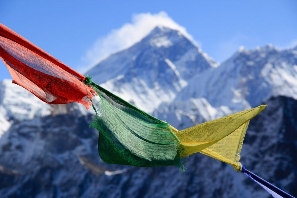 Everest 2019 - Flags with Everest in the background