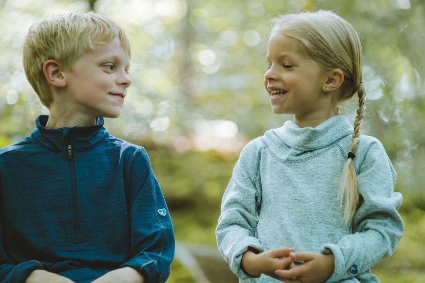 Have We Domesticated the Wild Child - A boy and a girl sitting in a forest.
