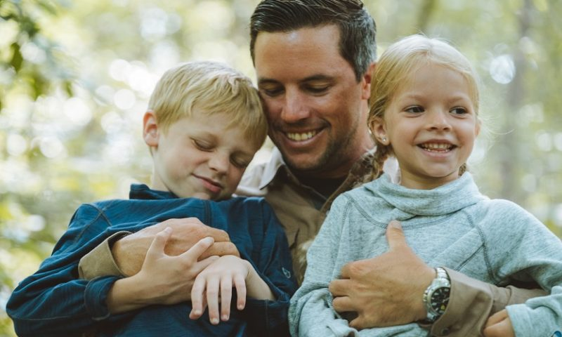 Have We Domesticated the Wild Child - A father and his children dressed in outdoor apparel