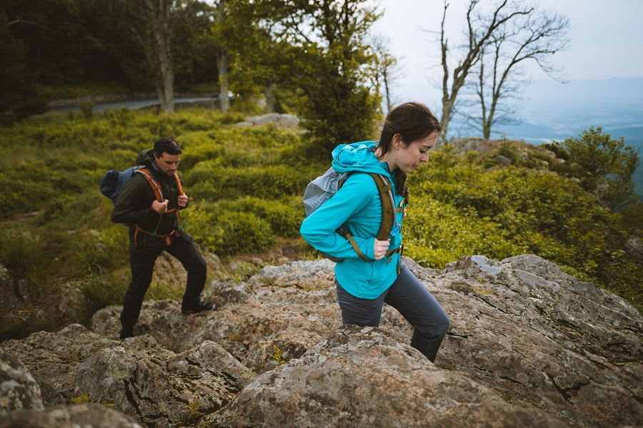 Indoorsy Partner to Outdoor Adventures - A man and a woman hiking in KUHL clothing.