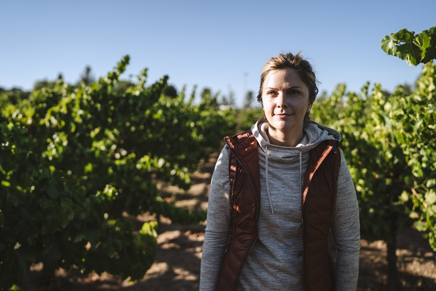 6 Ways to Salvage Your Summer - A woman dressed in KUHL clothing hiking in wine country