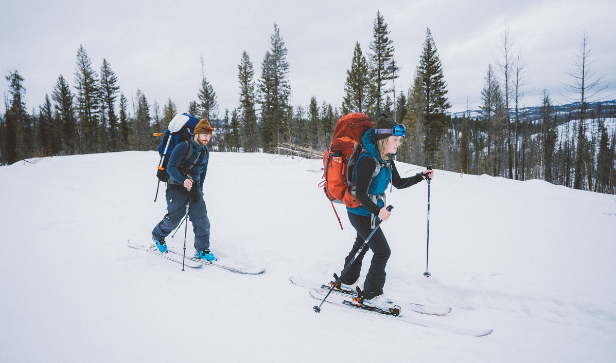 A man and a woman enjoying their winter hiking clothing