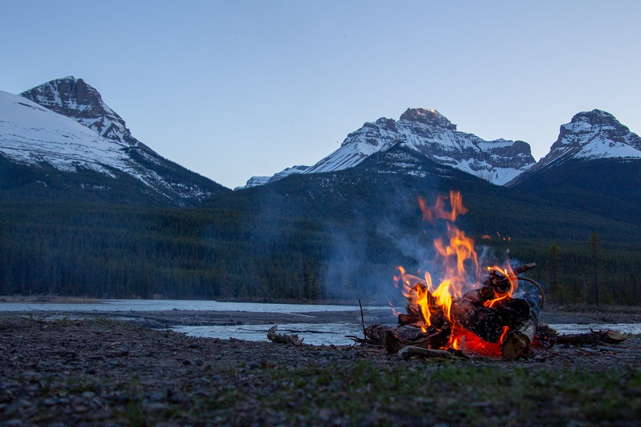 Bonfire near mountain in British Columbia, Canada.