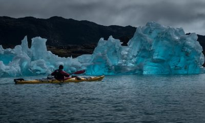 Man paddling with the icebergs in Southern Greenland