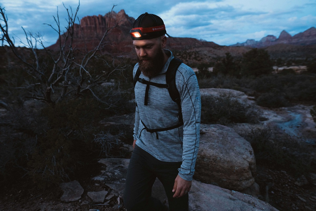 man walking with a head lamp