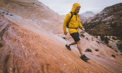 man in yellow jacket hiking