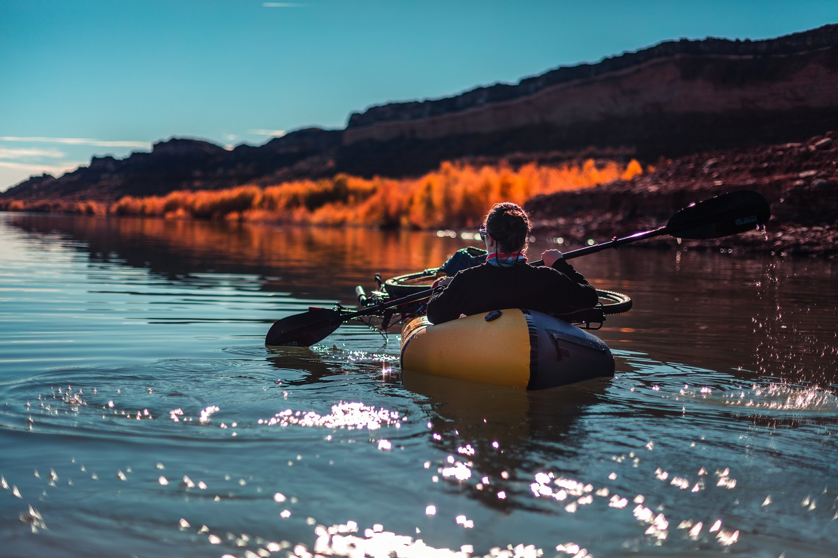 man paddling on inflatable boat