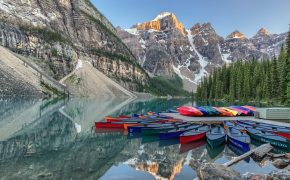 kayaks in front of mountain