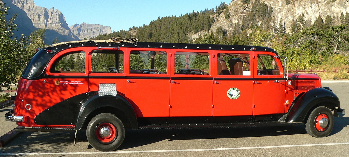 old red bus on mountain road