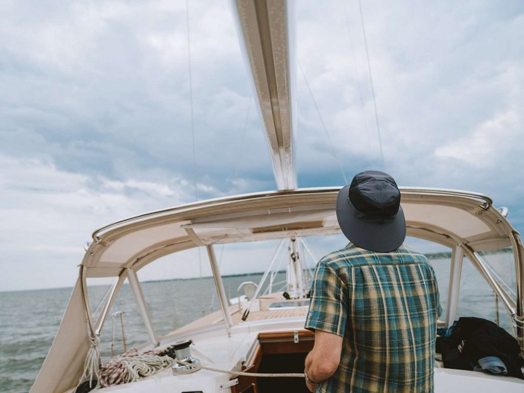 man with blue hat on boat