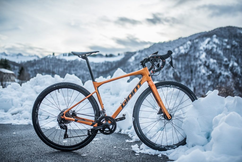 yellow and black mountain bike in snow