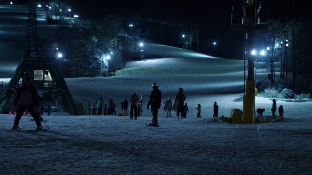 people on snowy ground at night