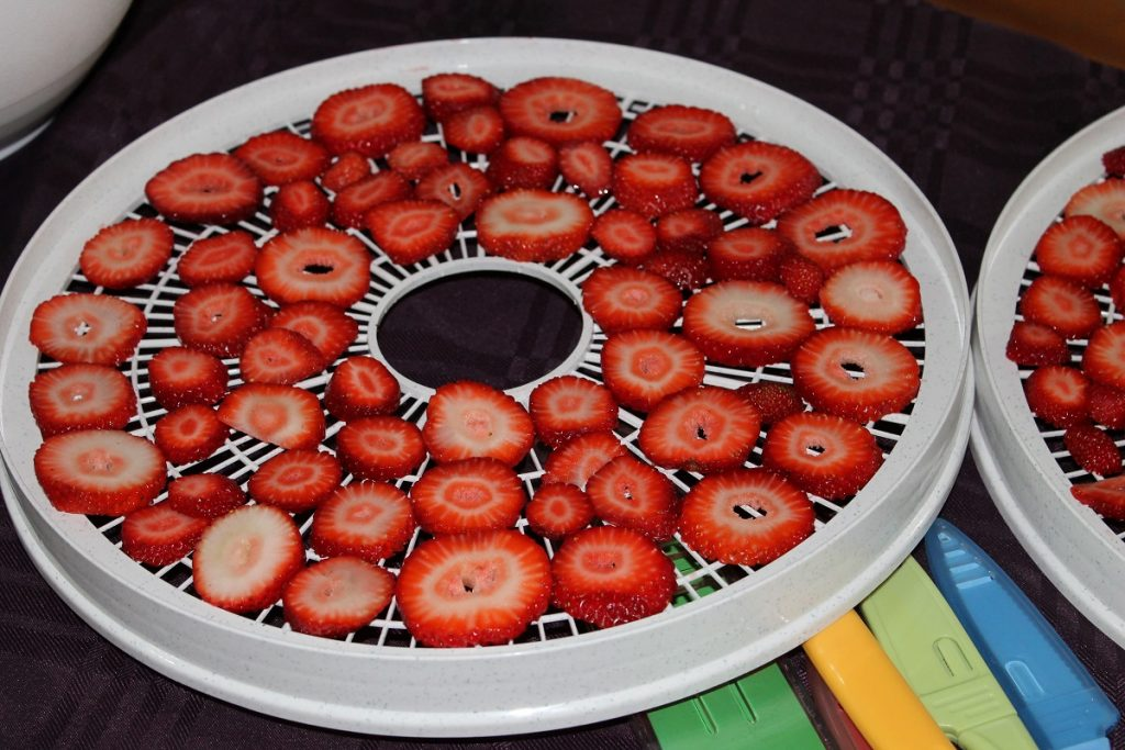 sliced red strawberries on white thin plate