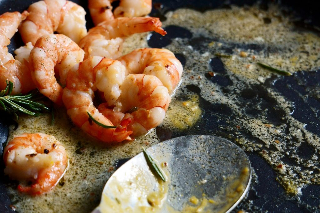 shrimps cooking on a black pan