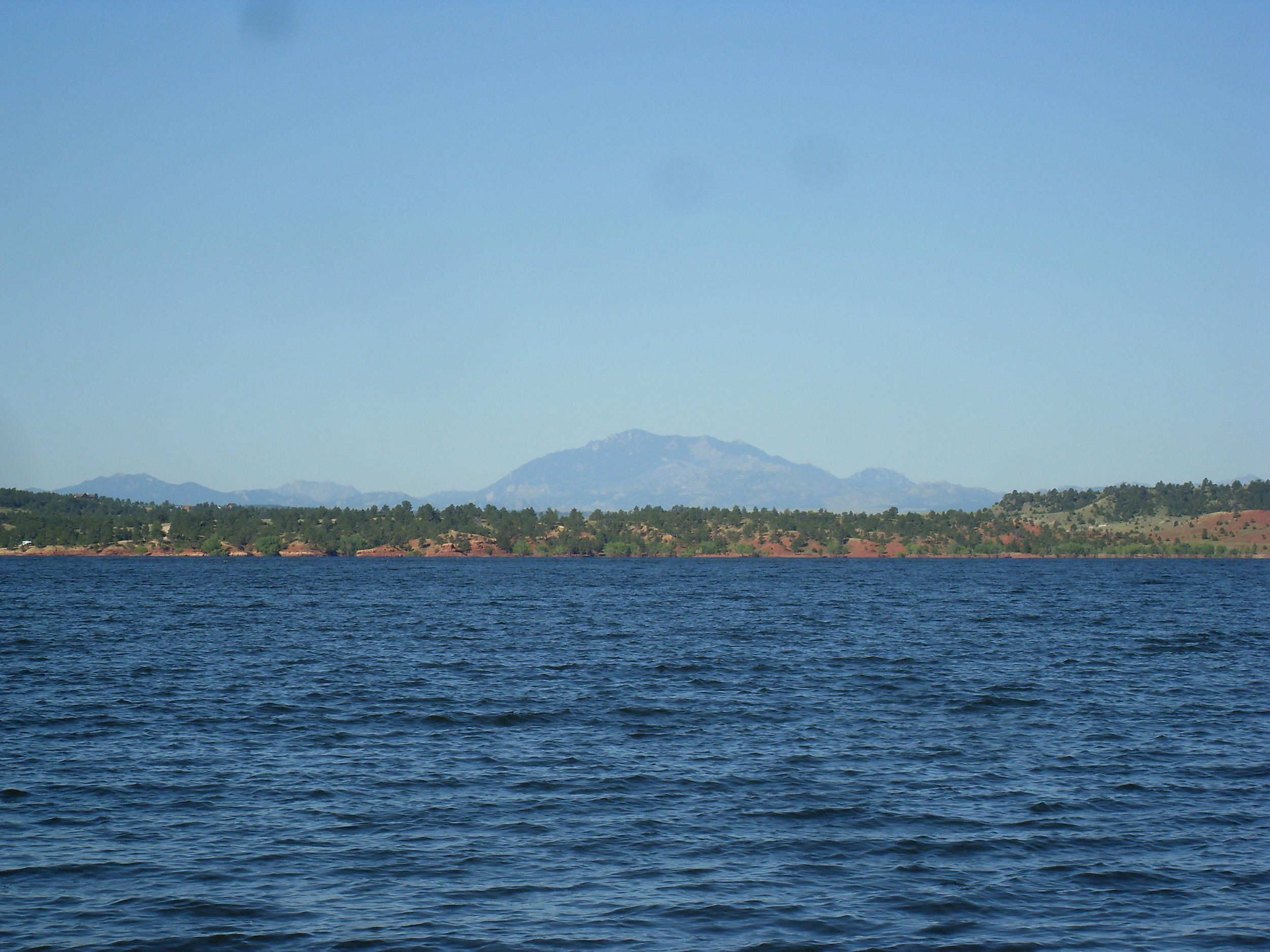 body of water with mountain peak in the back