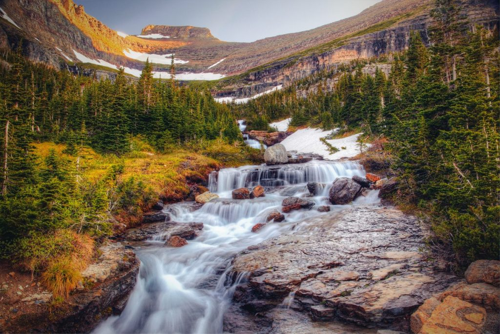flowing water surrounded by mountains