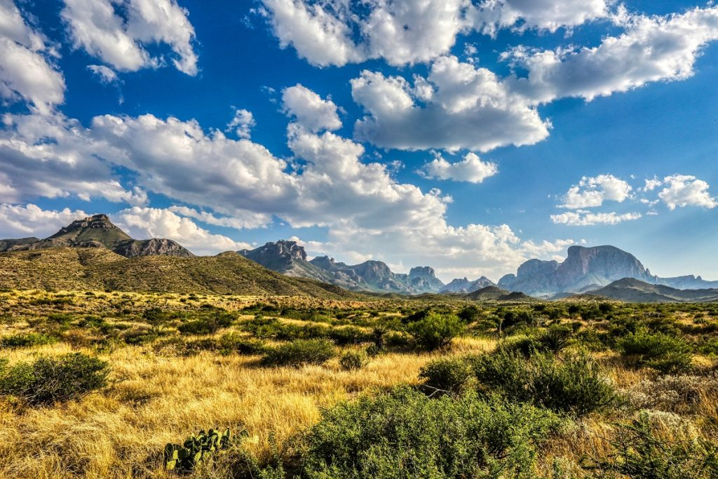 desert and mountains under blue sky