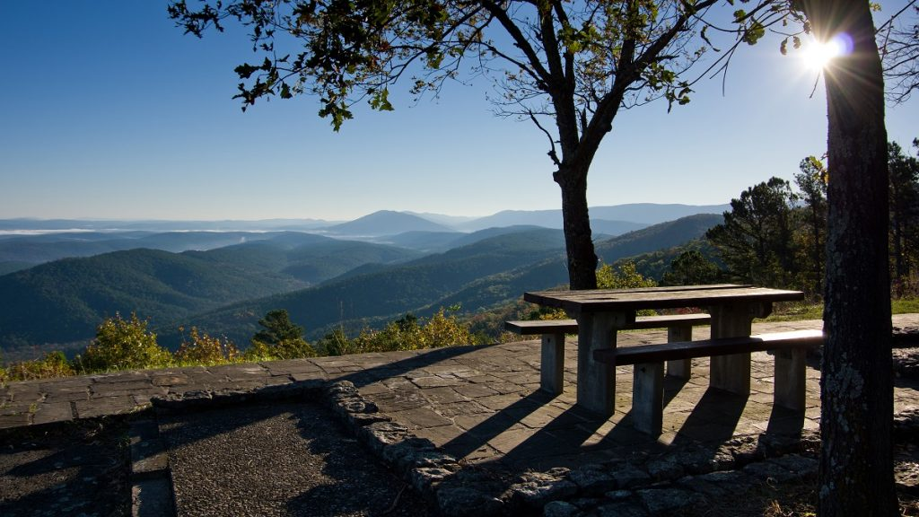 picnic tables on the overlook near mountains