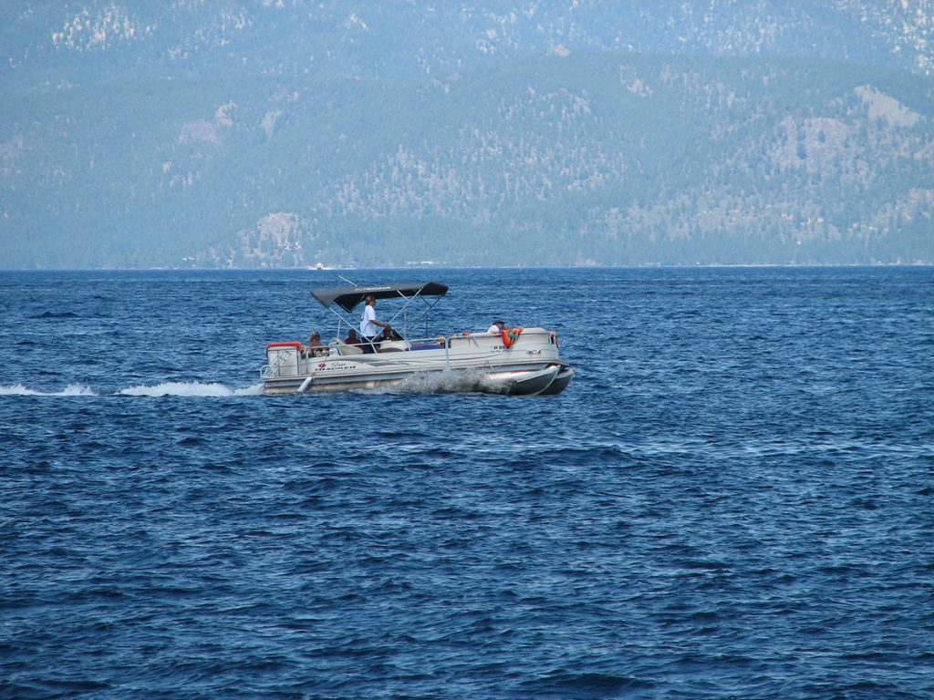 pontoon boat on body of water