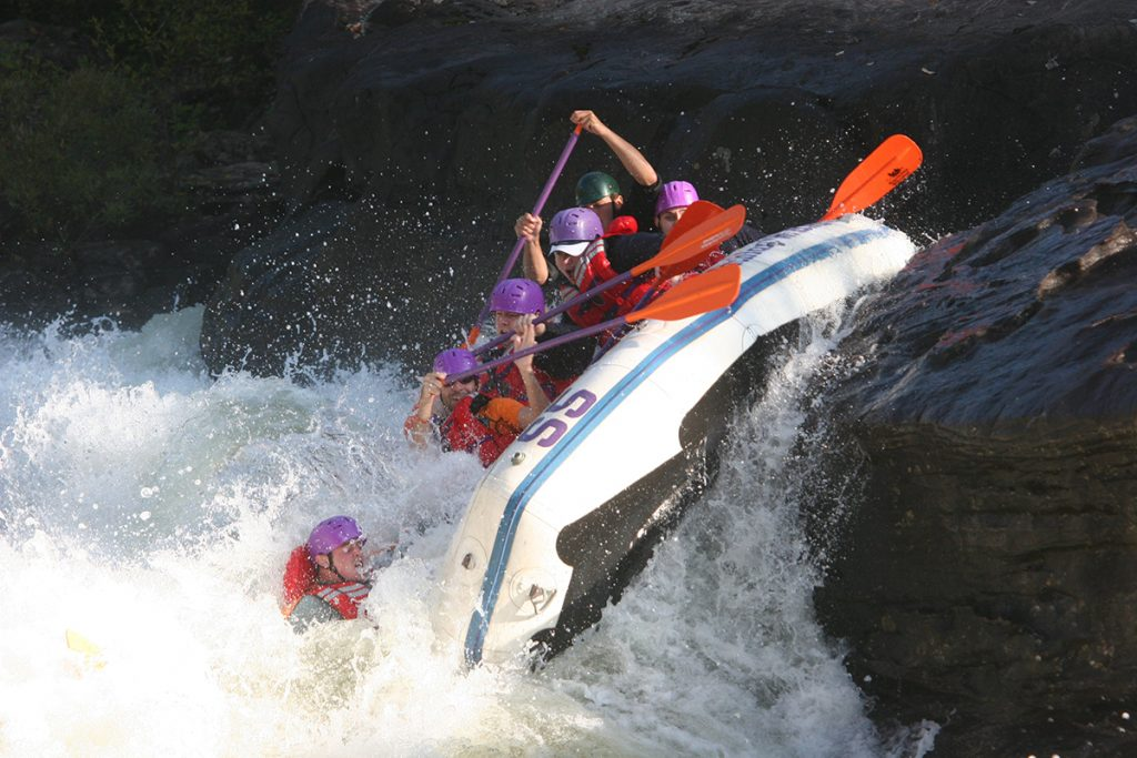people rafting in whitewater