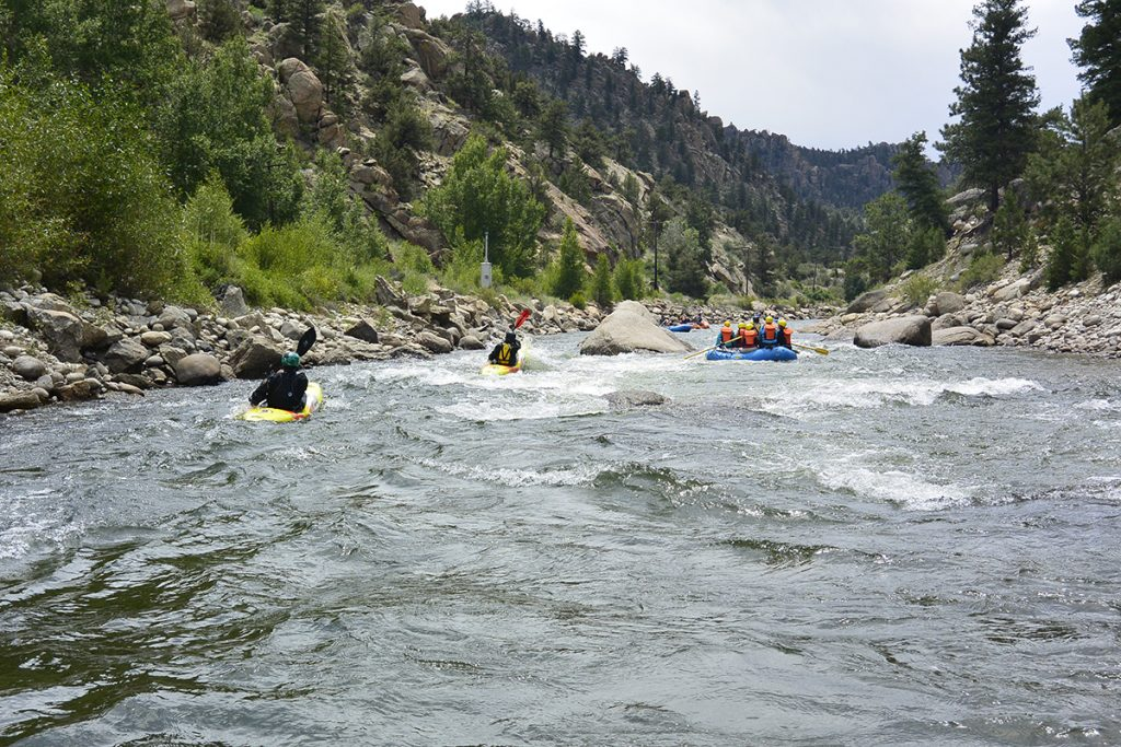 rafters and kayakers on the river