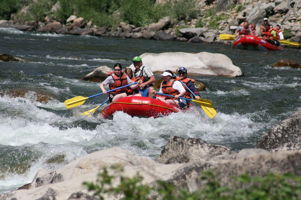whitewater rafting in red raft on the river