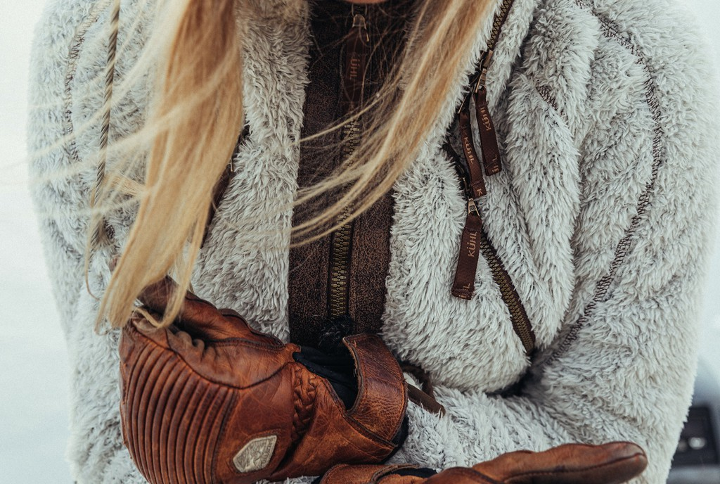 A lifestyle image of a blonde woman wearing women's fleece