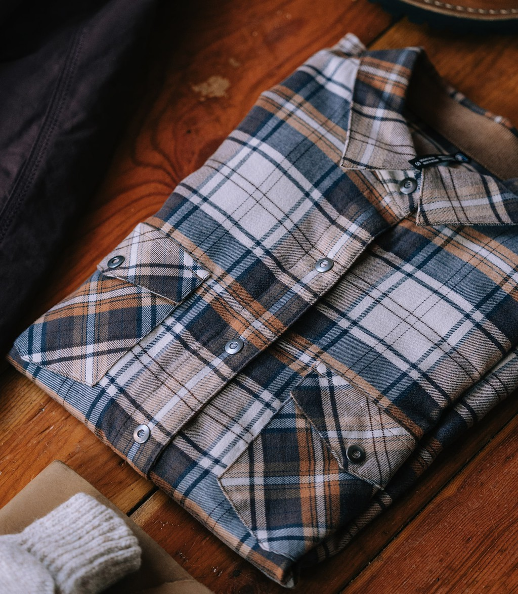 Neatly folded KUHL travelers flannel