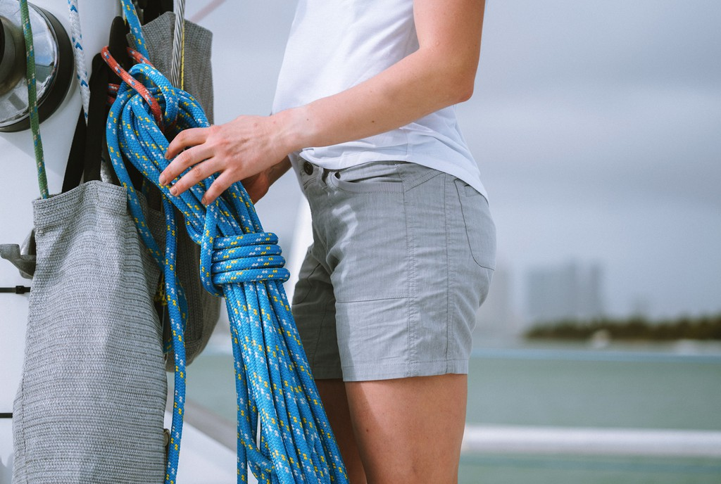 A woman standing next to a knot in women's outdoor shorts - Taken from KUHL Clothing Home Page
