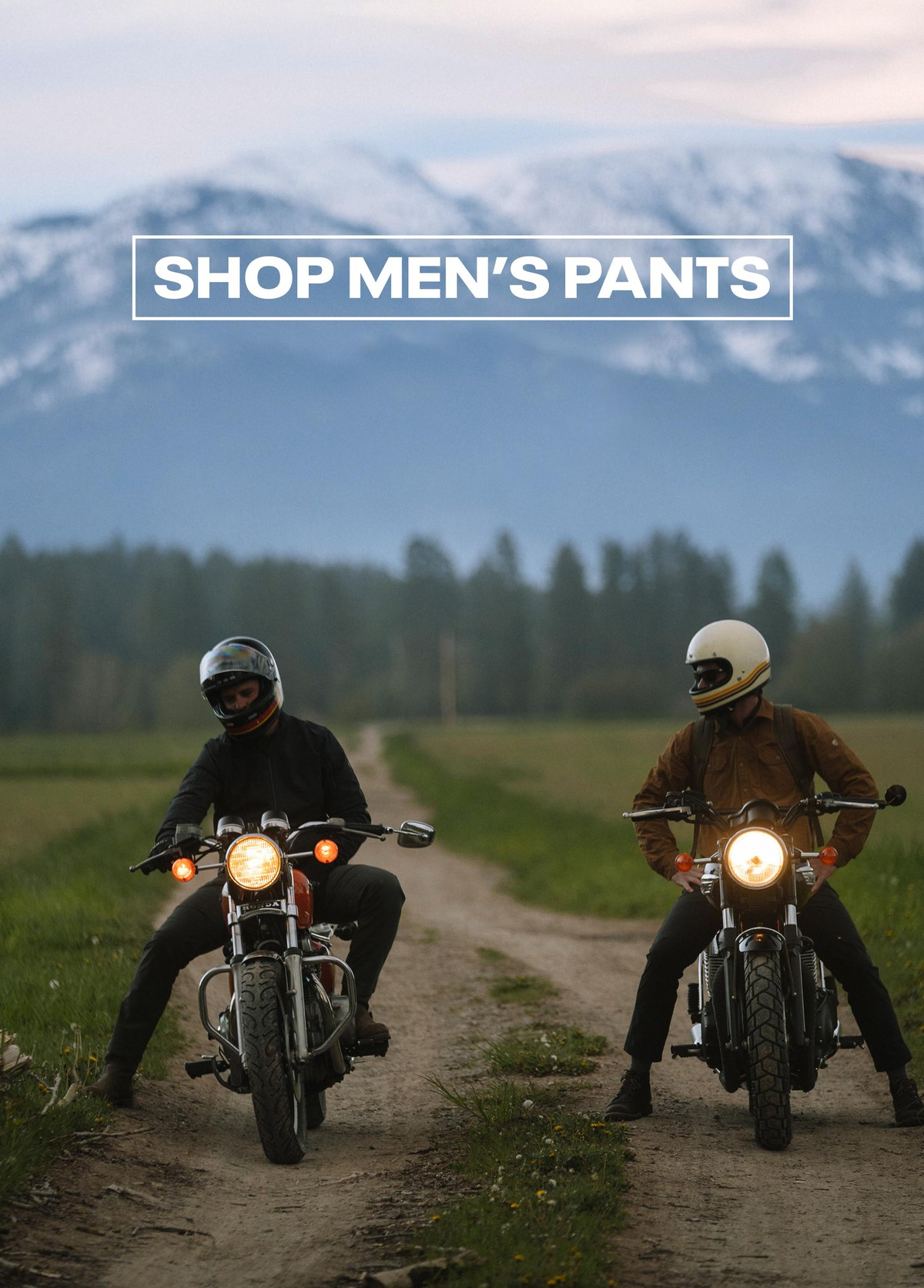 Two Men In Outdoor Clothing On A Motocycle - Taken from KUHL Clothing Home Page