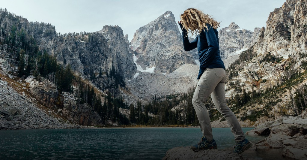 Woman on a mountain trail in outdoor clothing - Taken from KUHL Clothing Home Page