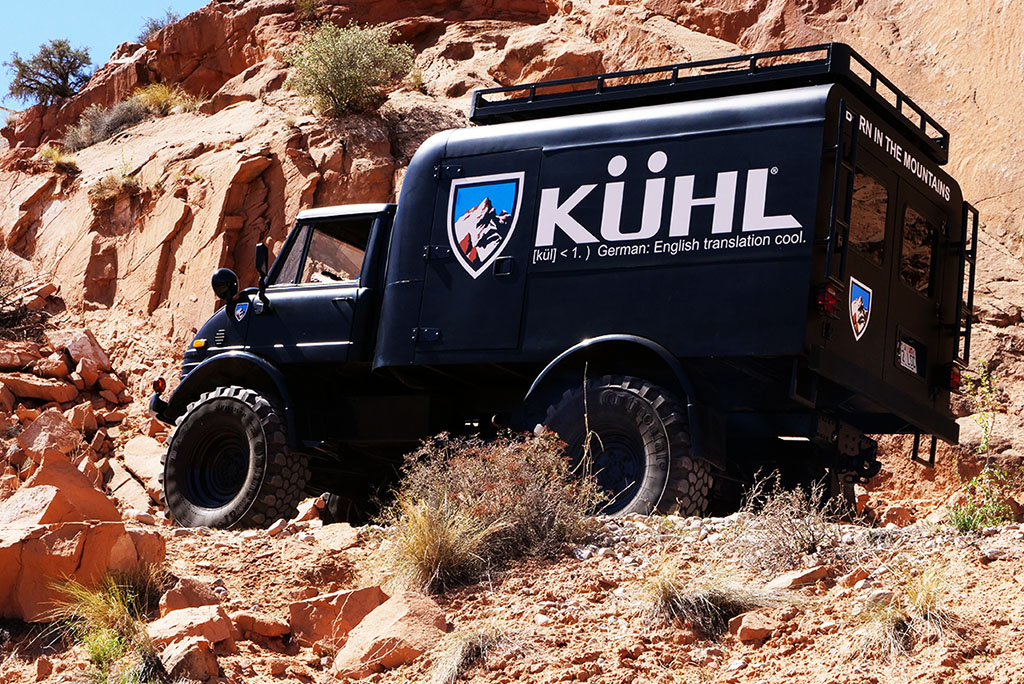 A front photo of KUHLMOG truck on a rocky mountain road