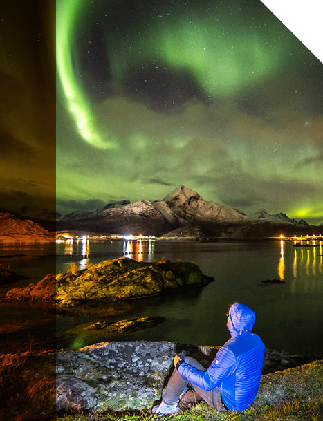 An image of a man in KUHL Spyfire Hoody looking at the northern lights