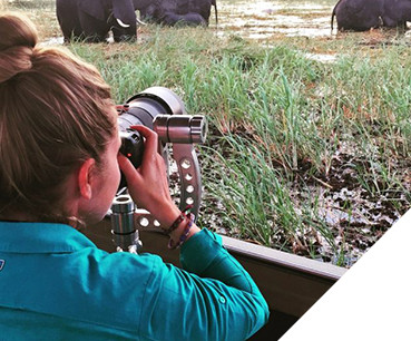 KUHL Ambassador Danielle watches animals on a safari, dressed in KUHL women's hiking clothing
