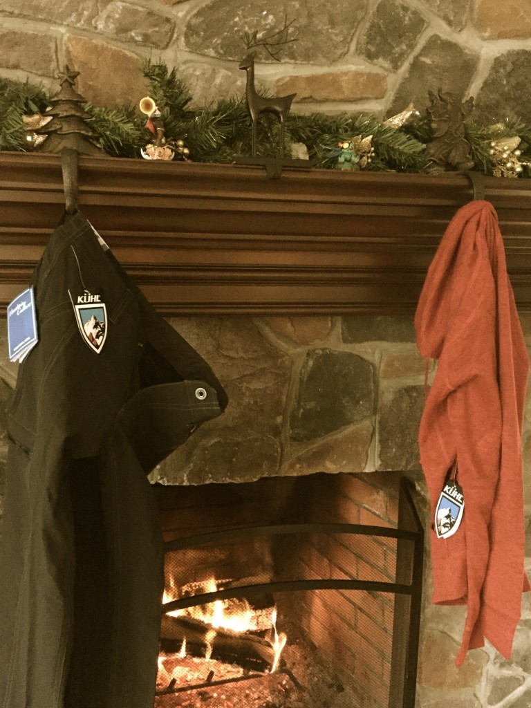 New Kuhl apparel hanging from the hearth